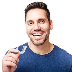 Man holding an Invisalign tray