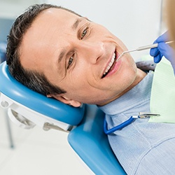 Man in dental chair for consultation.