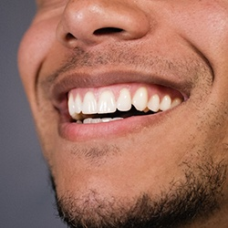 man smile teeth