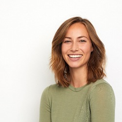 Woman in olive shirt smiling