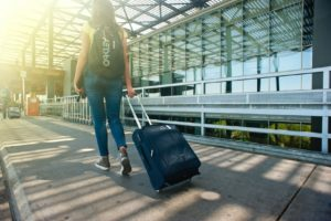 Woman using summer oral health tips while traveling