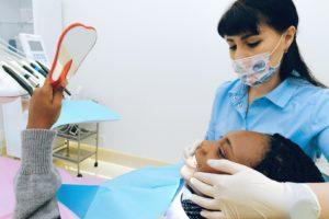 Woman at dentist replacing a metal crown